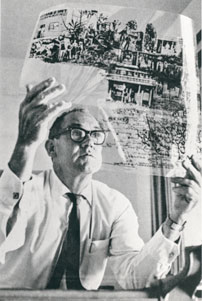 Photograph of Gordon Andrews checking a transparency of the layout for the $10 banknote, 1965