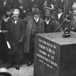 Premier of New South Wales James McGowen presents a gold trowel to the Bank's Governor, Denison Miller, as part of the ceremony for the laying of the foundation stones for the Commonwealth Bank's head office, Sydney, 14 May 1913. PN-000835