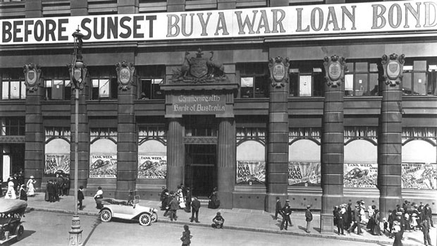 Photograph of advertisements for the Sixth War Loan displayed prominently on the Commonwealth Bank of Australia's façade, Moore Street (now Martin Place), Sydney, April 1918. PN-001623