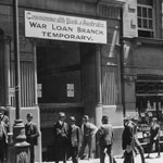 Temporary War Loan Branch at the Commonwealth Bank of Australia in Dalton's Building, Pitt Street, Sydney, 1916, possibly during the Third War Loan. The branch was opened to cater for the enormous increase in work. PN-001691