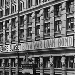 The Commonwealth Bank of Australia's head office, Moore Street (now Martin Place), Sydney. The building displays a banner ('Before Sunset Buy A War Loan Bond') encouraging the public to subscribe to the Sixth War Loan campaign, 1918. PN-001624