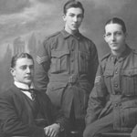 Staff group from the Commonwealth Bank of Australia Hurdcott Military Branch, England, 1919. From left: AC Iny, CJ Eade, P Bostock, and RCO Atkinson. The branch opened in September 1918. In order to ease the Bank's severe staff shortages in England, the Army Council authorised the Bank to take on a temporary staff of Australian soldiers, who were recovering from illness or injury. PN-001406