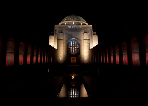 Harrison's name is projected on the Australian War Memorial at night.